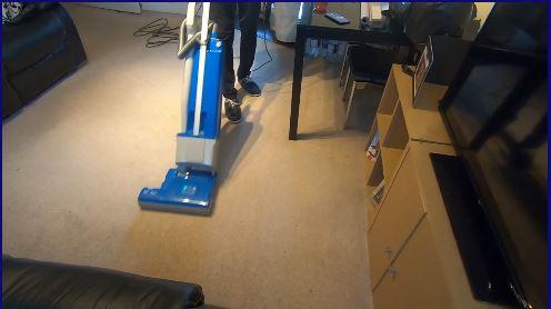 Cleaner hoovering a home in Milton Keynes